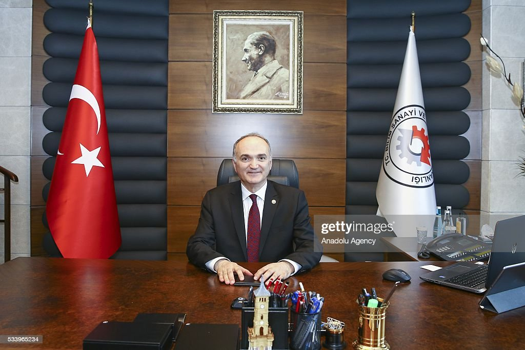 Turkey's new Minister of Science, Industry and Technology Faruk Ozlu (C) meets with outgoing Minisiter of Science, Industry and Technology Fikri Isik (not seen) for an inauguration ceremony at the ministry's building in Ankara, Turkey on May 24, 2016.