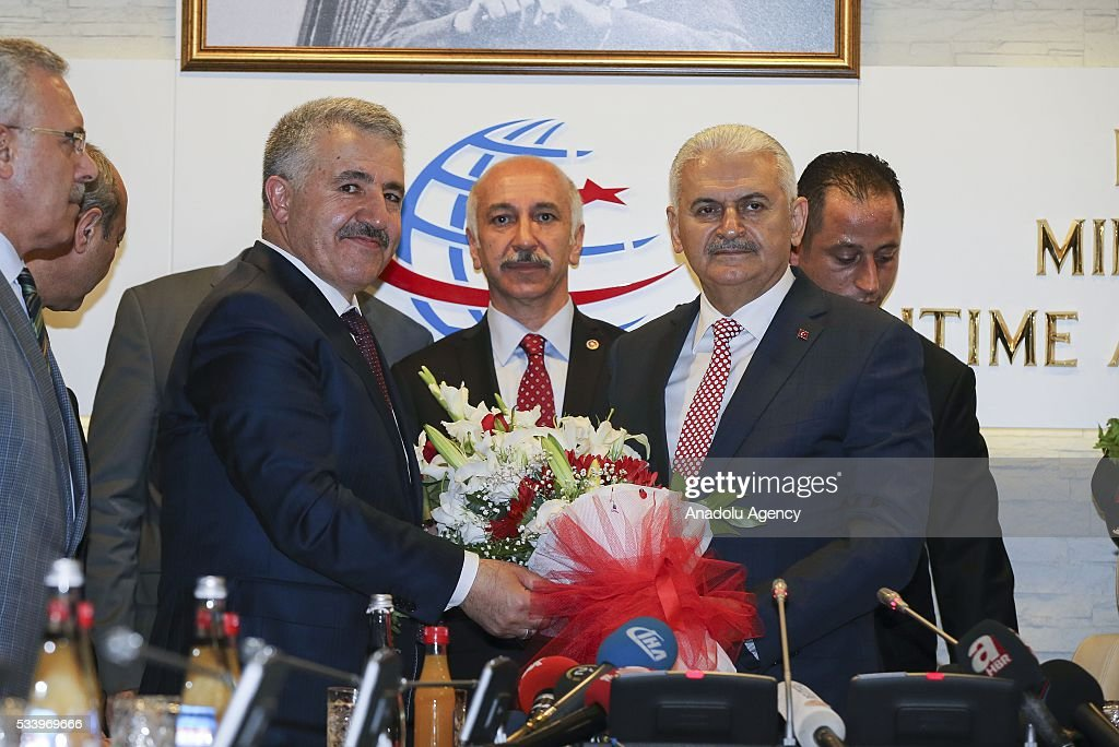 Turkey's new Minister of Transportation, Maritime and Communication Ahmet Arslan (L) meets with his predecessor and Turkey's new Prime Minister Binali Yildirim (R) for an inauguration ceremony at the ministry's building in Ankara, Turkey on May 24, 2016.