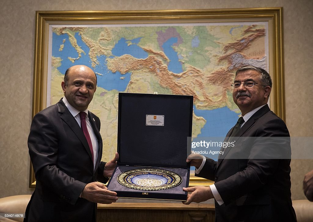 Turkey's new National Defense Minister Fikri Isik (L) and his predecessor Ismet Yilmaz (R) are seen during the handover ceremony in Ankara, Turkey on May 24, 2016.