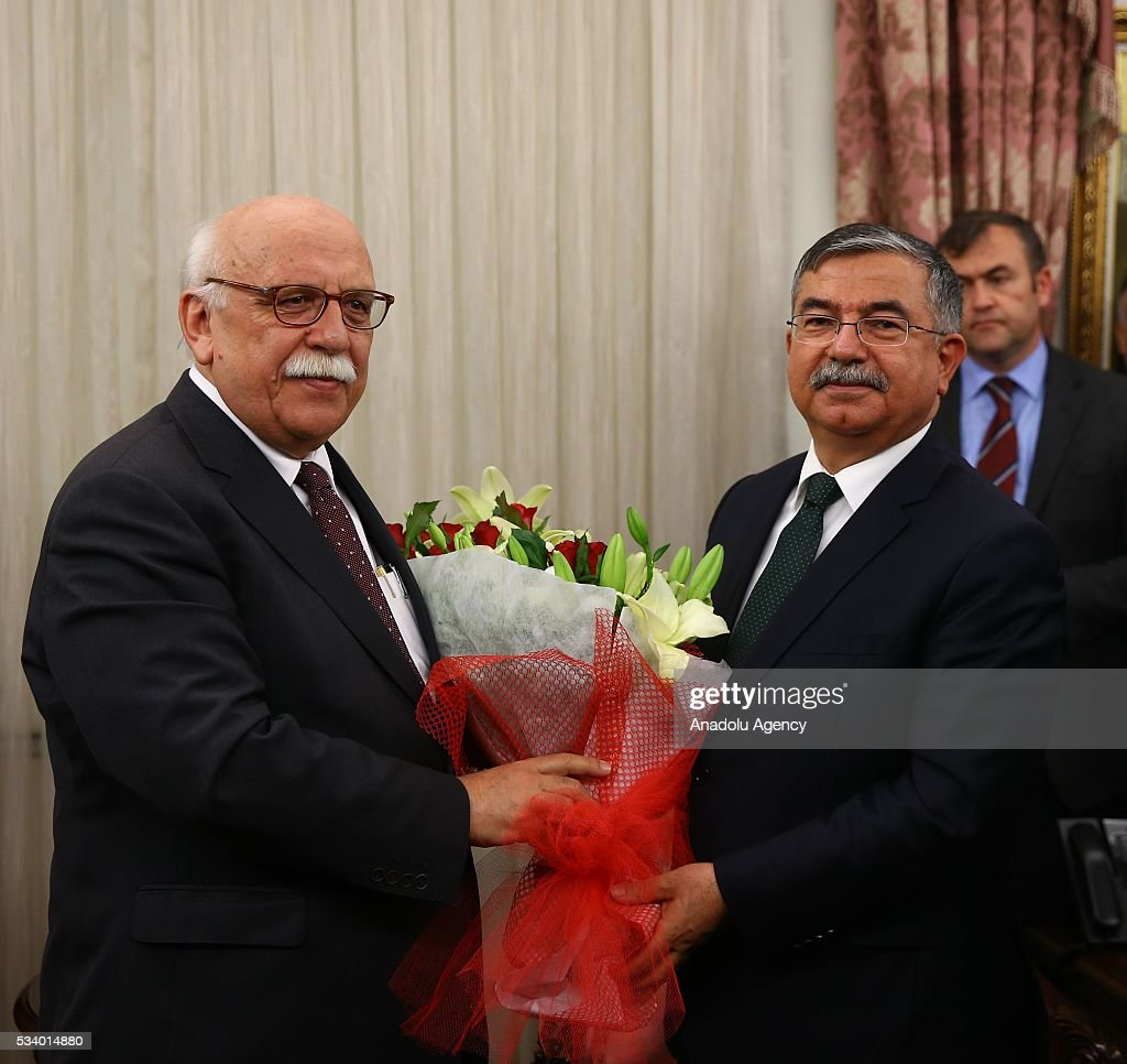 Turkey's new National Education Minister Ismet Yilmaz (R) and his predecessor Nabi Avci (L) are seen during the handover ceremony in Ankara, Turkey on May 24, 2016.