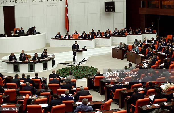 Turkey's new Prime Minister Ahmet Davutoglu presents his cabinet's programme to the parliament in Ankara on September 1 2014 Turkish President Recep...