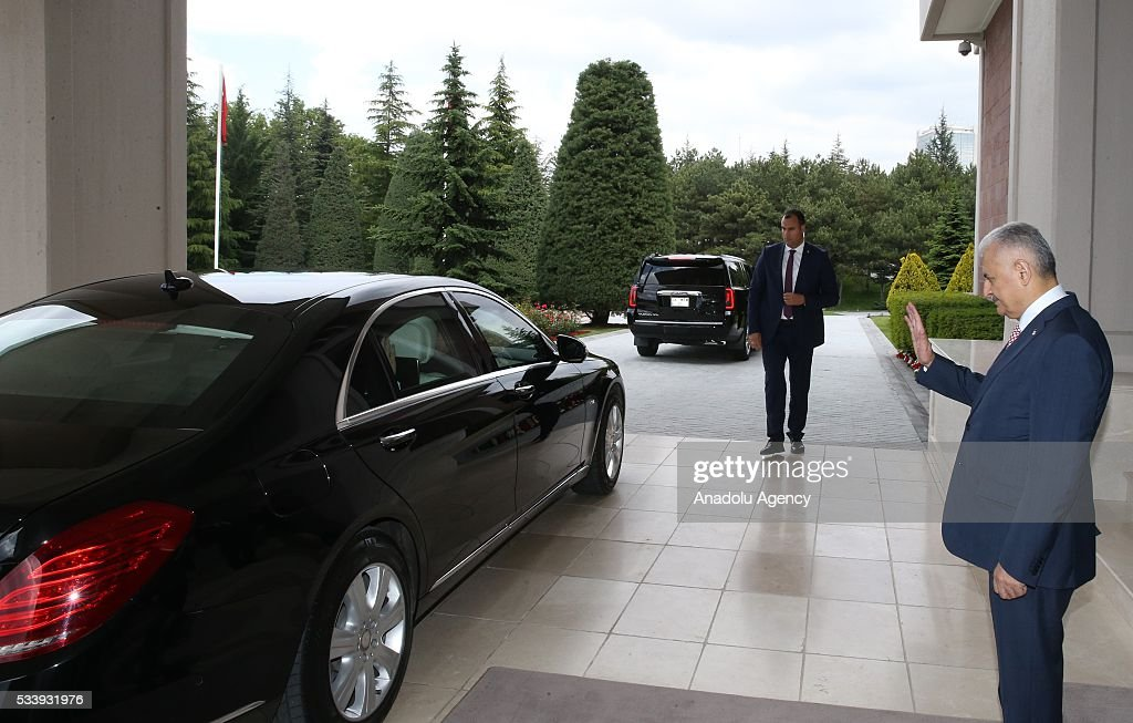 Turkey's new Prime Minister and the leader of Turkey's ruling party, the Justice and Development Party (AK Party) Binali Yildrim (R) bids farewell outgoing Prime Minister Ahmet Davutoglu (not seen) after an inauguration ceremony at Prime Ministerial Cankaya Palace in Ankara, Turkey on May 24, 2016.