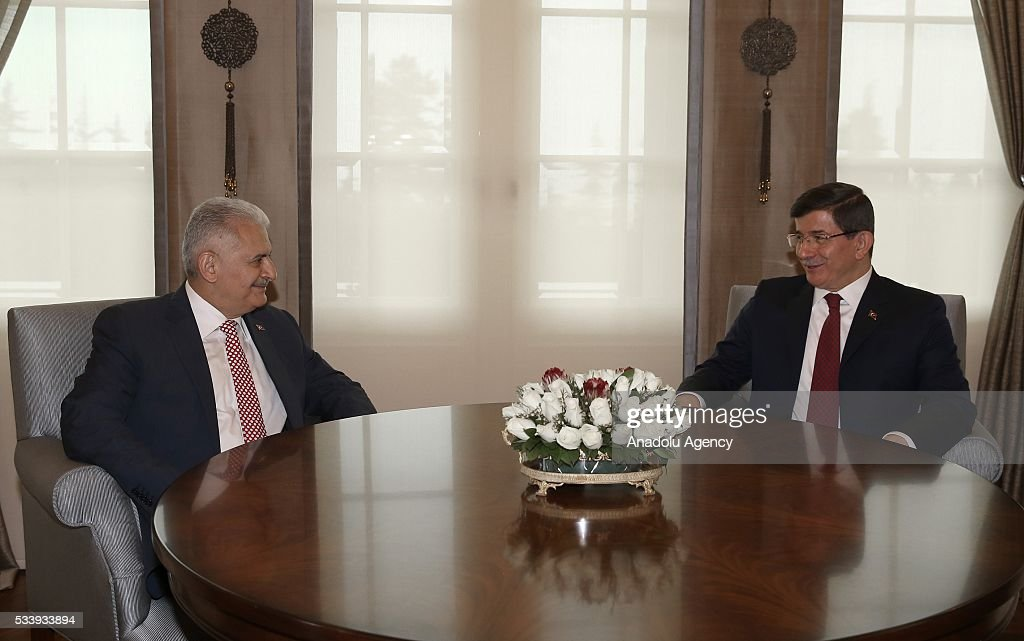 Turkey's new Prime Minister and the leader of Turkey's ruling party, the Justice and Development Party (AK Party) Binali Yildrim (L) meets with outgoing Prime Minister Ahmet Davutoglu (R) for an inauguration ceremony at Prime Ministerial Cankaya Palace in Ankara, Turkey on May 24, 2016.