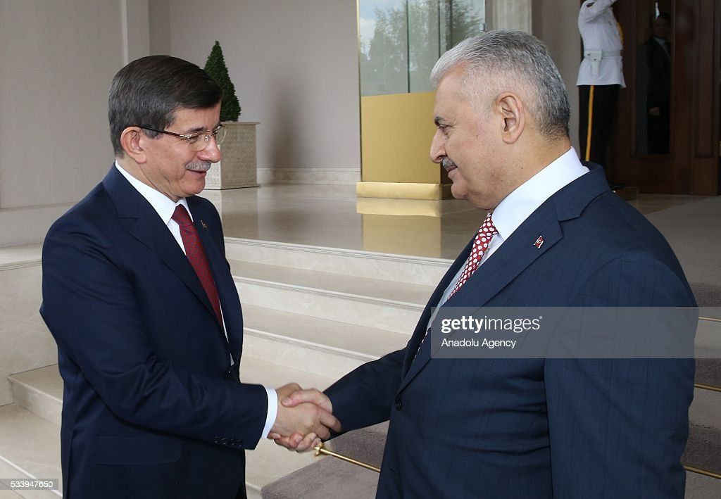 Turkey's new Prime Minister and the leader of Turkey's ruling party, the Justice and Development Party (AK Party) Binali Yildrim (L) shakes hand with outgoing Prime Minister Ahmet Davutoglu (R) after an inauguration ceremony at Prime Ministerial Cankaya Palace in Ankara, Turkey on May 24, 2016.