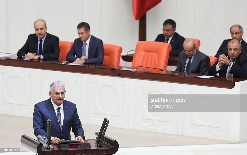 Turkey's new Prime Minister Binali Yildirim (Foreground) speaks from the podium at the general session at Grand National Assembly of Turkey (TBMM) in Ankara, Turkey on May 29, 2016. Turkeys new government won a parliamentary vote of confidence with ruling Justice and Development Party (AKP) Chairman and Prime Minister Binali Yildirims government receiving 315 votes, while 138 lawmakers voted against the administration. / AFP / ADEM