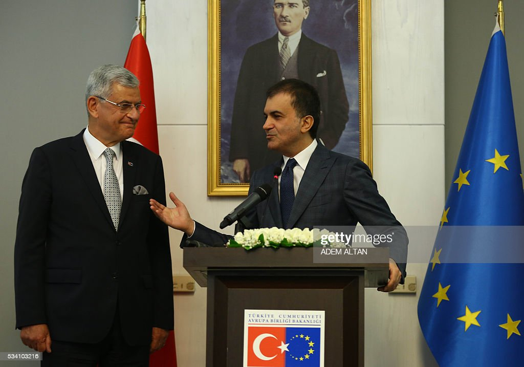 Turkey's newly appointed EU Affairs Minister and Chief Negotiator Omer Celik (R) delivers a speech next to his predecessor Volkan Bozkir (L) during the handover ceremony in Ankara, on May 24, 2016. / AFP / ADEM