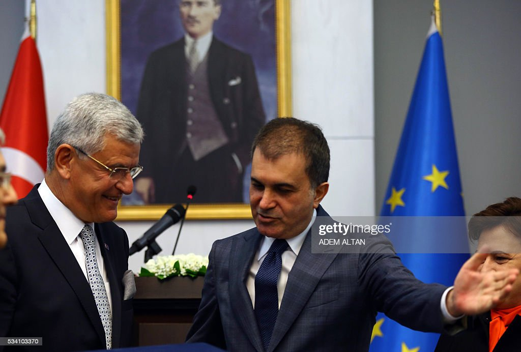 Turkey's newly appointed EU Affairs Minister and Chief Negotiator Omer Celik (R) speaks with his predecessor Volkan Bozkir (L) during the handover ceremony in Ankara, on May 25, 2016. / AFP / ADEM