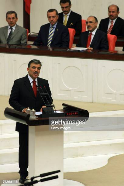 Turkey's newly elected President Abdullah Gul takes the oath of office while watched Prime Minister Tayyip Erdogan and his ministers Besir Atalay and...