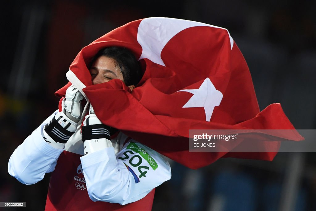 TOPSHOT Turkey's Nur Tatar celebrates after winning against Taiwan's Chuang ChiaChia in their womens taekwondo bronze medal bout in the 67kg category...
