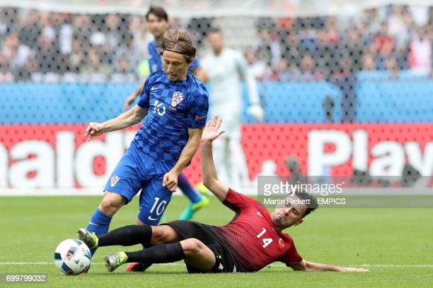 Turkey's Oguzhan Ozyakup and Croatia's Luka Modric battle for the ball