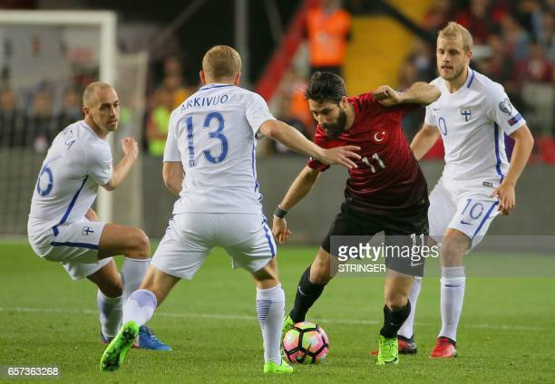 Turkey's Olcay Sahan vies for the ball with Finland's Sakari Mattila Kari Arkivuo and Teemu Pukki during the FIFA World Cup 2018 qualification...