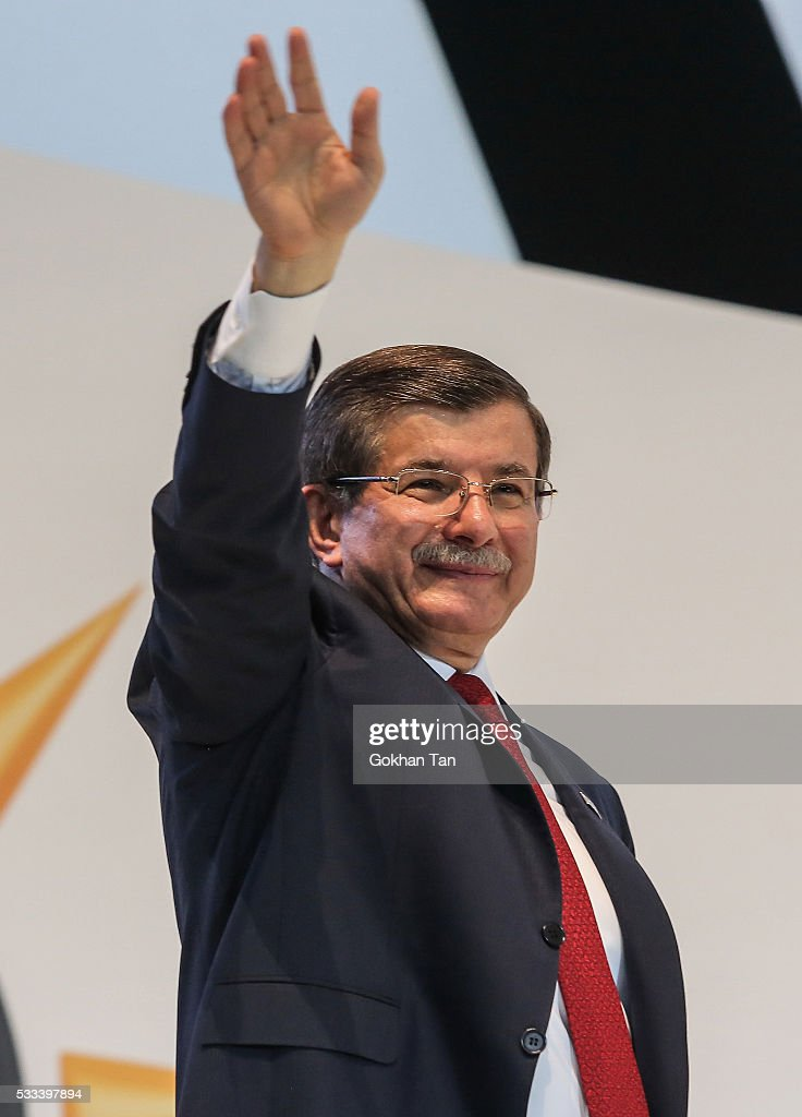 Turkey's outgoing Prime Minister Ahmet Davutoglu waves to the supporters during the Extraordinary Congress of the ruling AK Party (AKP) to choose the new leader of the party on May 22, 2016 in Ankara, Turkey. Turkey's Transport and Communication Minister Binali Yildirim is the sole candidate to head AK Party and as the new Prime Minister of Turkey.