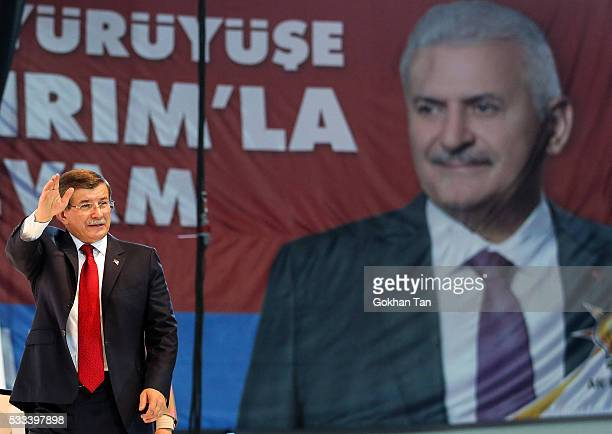 Turkey's outgoing Prime Minister Ahmet Davutoglu waves to the supporters during the Extraordinary Congress of the ruling AK Party to choose the new...