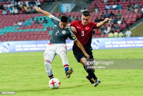 Turkey's player Melih Gokcimen duels for the ball against Paraguay's Jesus Rolon during the FIFA U17 World Cup match between Turkey and Paraguay in...