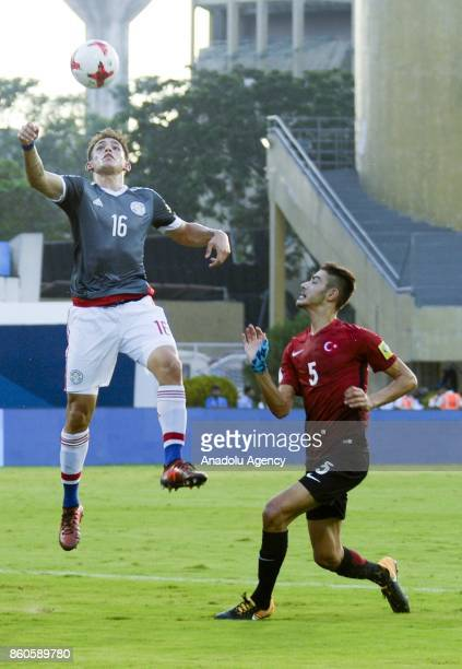 Turkey's player Ozan Kabak duels for the ball against Paraguay's Anibal Vega during the FIFA U17 World Cup match between Turkey and Paraguay in...