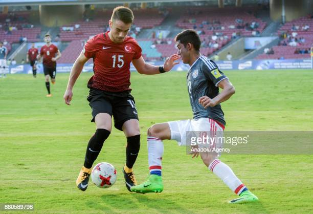 Turkey's player Yunus Akgun duels for the ball against Paraguay's Blas Armoa during the FIFA U17 World Cup match between Turkey and Paraguay in...