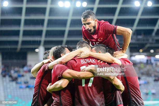 Turkey's players celebrate after scoring a goal during the preEuro 2016 football friendly match at Stadium Stozice in Ljubljana Slovenia on June 5...
