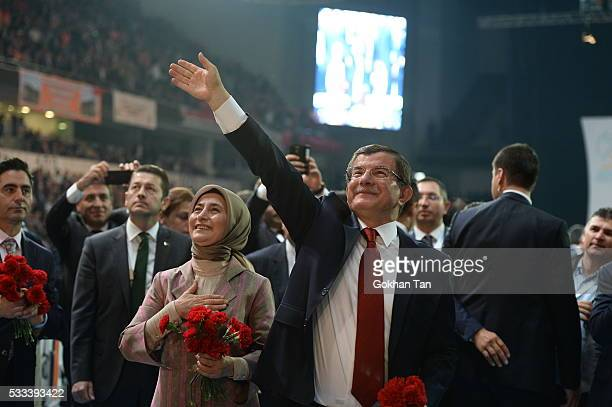 Turkey's PM Ahmet Davutoglu accompanied by his wife Sare Davutoglu greets members of his party as he arrives for the second Extraordinary Congress of...