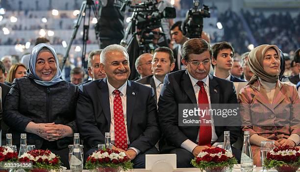 Turkey's PM Ahmet Davutoglu and his wife Sare Davutoglu Transport and Comunication Minister Binali Yildirim and his wife Semiha Yildirim sit together...