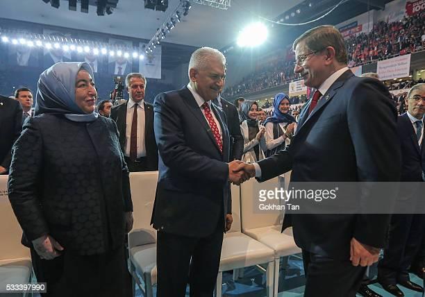 Turkey's PM Ahmet Davutoglu greets Transport and Comunication Minister Binali Yildirim and his wife Semiha Yildirim during the Extraordinary Congress...