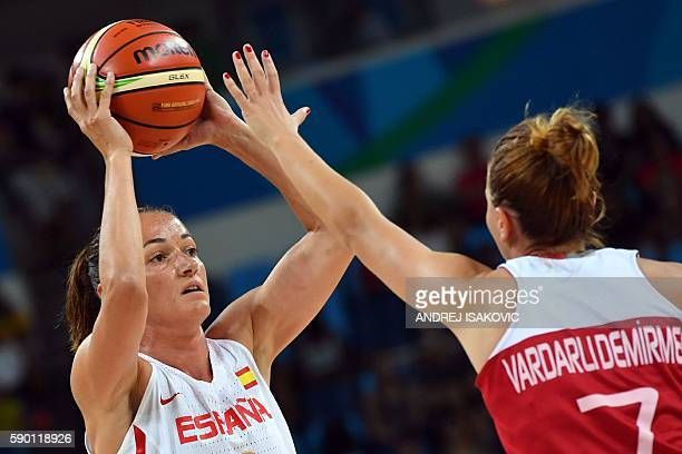 Turkey's point guard Birsel Vardarli Demirmen holds off Spain's point guard Laia Palau during a Women's quarterfinal basketball match between Spain...
