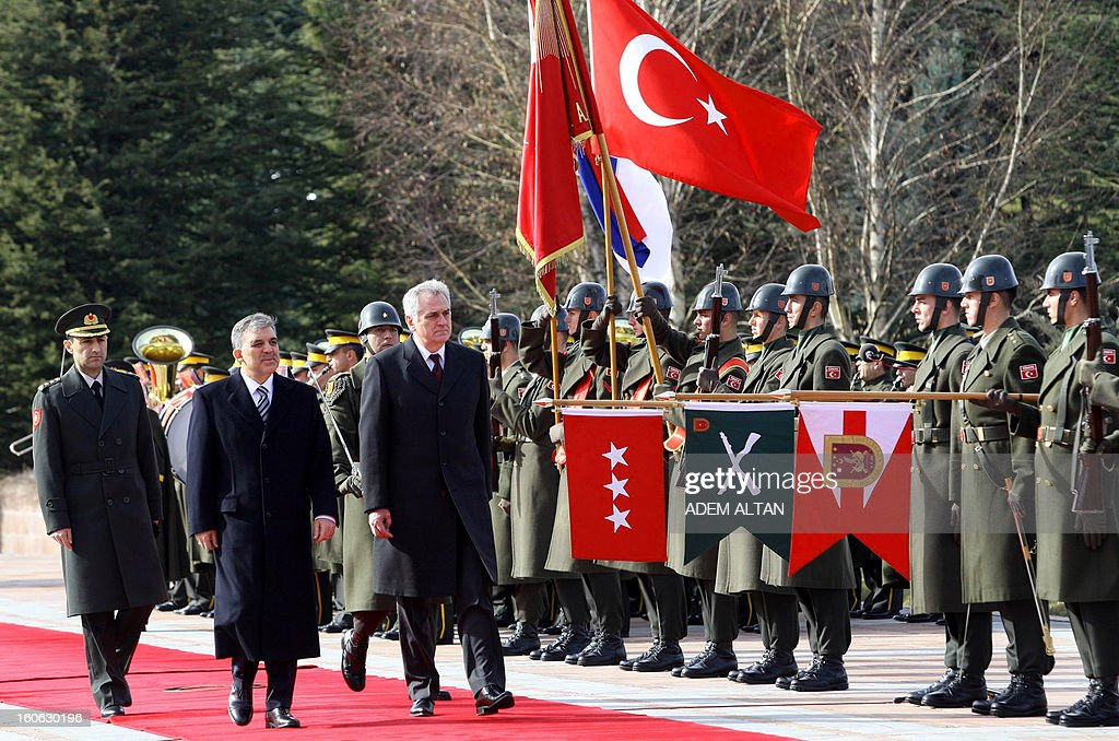 Turkey's President Abdullah Gul (2nd-L) and his Serbian counterpart Tomislav Nikolic (R) review a military guard of honour during a welcoming ceremony at the Cankaya Presidential Palace in Ankara on February 4, 2013.