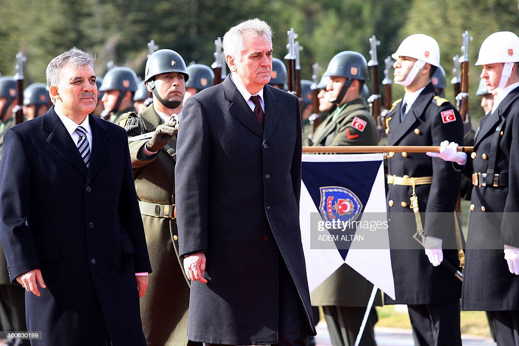 Turkey's President Abdullah Gul (L) and his Serbian counterpart Tomislav Nikolic (C) review a military guard of honour during a welcoming ceremony at the Cankaya Presidential Palace in Ankara on February 4, 2013. AFP PHOTO/ADEM ALTAN