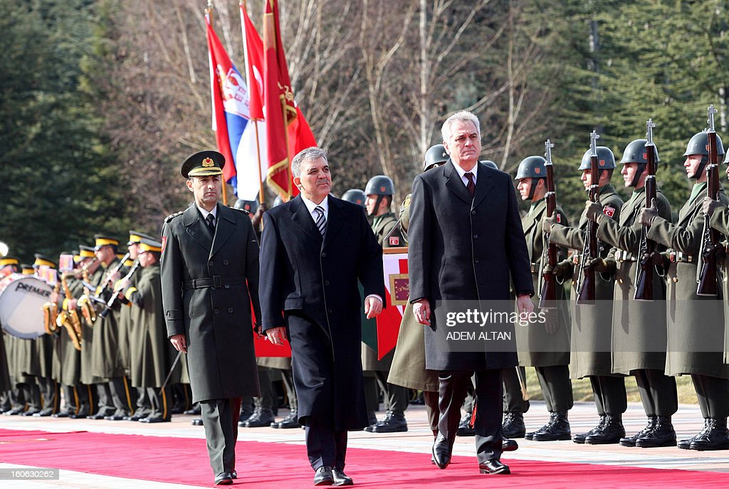 Turkey's President Abdullah Gul (C) and his Serbian counterpart Tomislav Nikolic (R) review a military guard of honour during a welcoming ceremony at the Cankaya Presidential Palace in Ankara on February 4, 2013.