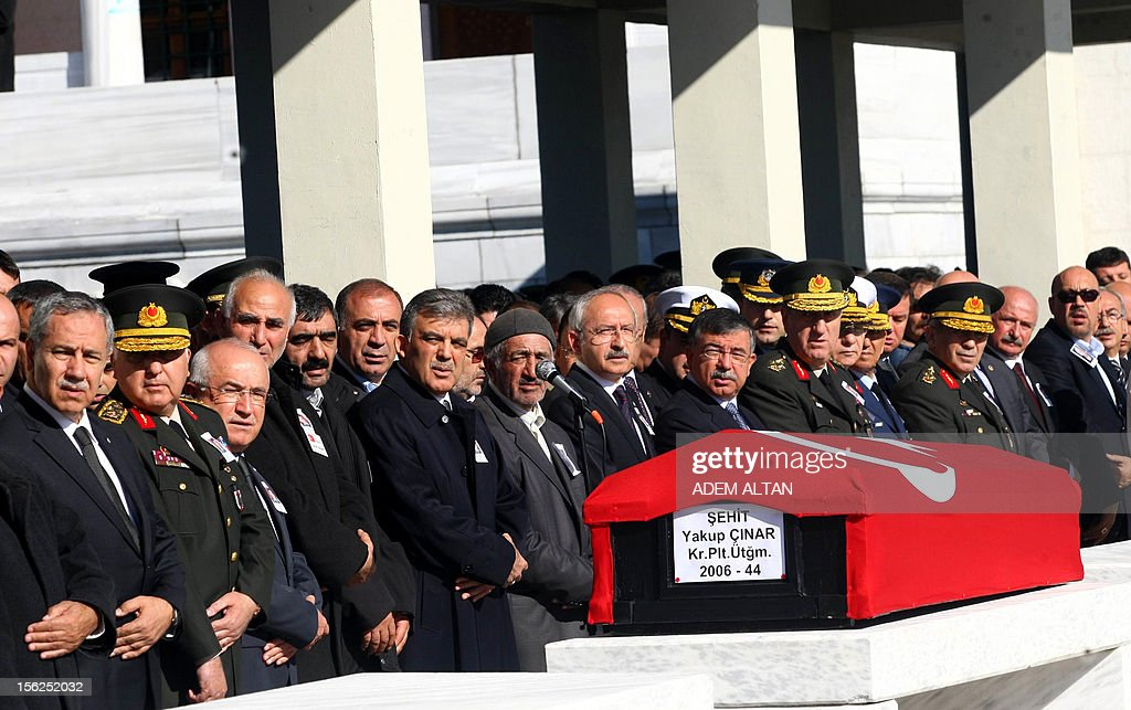 Turkey's President Abdullah Gul (6R), Chief of Staff General Necdet Ozel (2L) and family members attend a funeral prayer for air force pilot Yakup Cinar, one of 17 Turkish soldiers who were killed in a helicopter crash early on November 9, 2012 in Siirt province, during his funeral in Ankara on November 12, 2012. The Turkish military helicopter crashed on November 9, 2012 in bad weather in the southeastern city of Siirt, killing all 17 troops on board, local officials said.