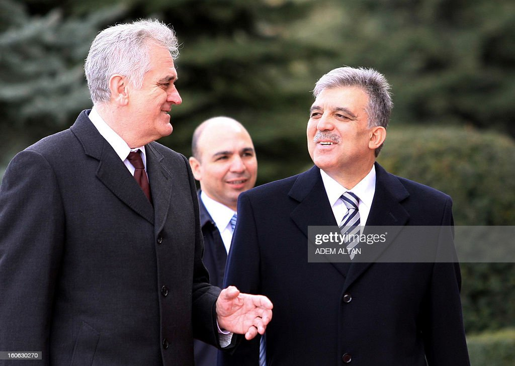 Turkey's President Abdullah Gul (R) walks with his Serbian counterpart Tomislav Nikolic (L) during a welcoming ceremony at the Cankaya Presidential Palace in Ankara on February 4, 2013.