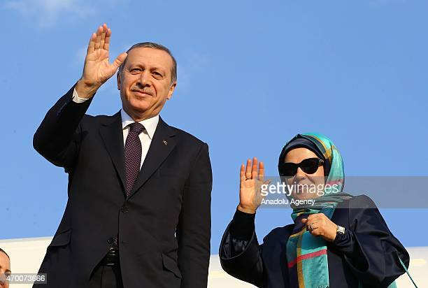 Turkey's President Recep Tayyip Erdogan and his wife Emine Erdogan are seen in front of the Presidential Plane at Shymkent International Airport as...