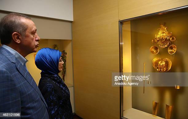 Turkey's President Recep Tayyip Erdogan and his wife Emine Erdogan look at a preHispanic golden artifact as they tour the Gold Museum in Bogota...