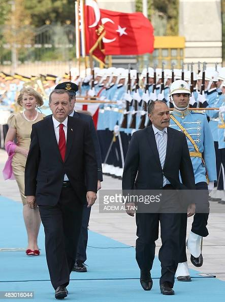 Turkey's President Recep Tayyip Erdogan and New Zealand's GovernorGeneral Jerry Mateparae review a guard of honour during an official welcoming...