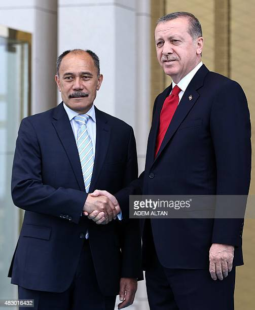 Turkey's President Recep Tayyip Erdogan and New Zealand's GovernorGeneral Jerry Mateparae shake hands during an official welcoming ceremony at the...
