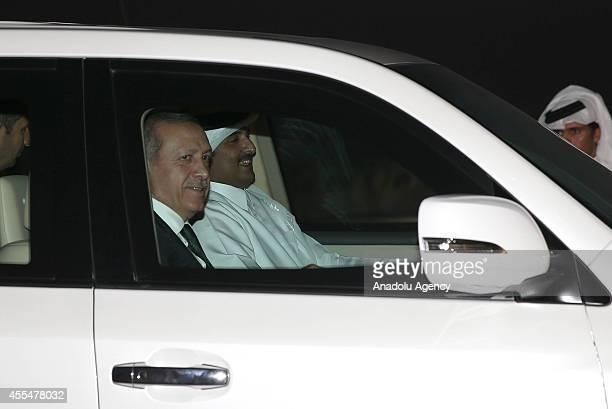 Turkeys President Recep Tayyip Erdogan and Qatar's emir Sheikh Tamim bin Hamad Al Thani go to the Doha Hamad International airport after the...