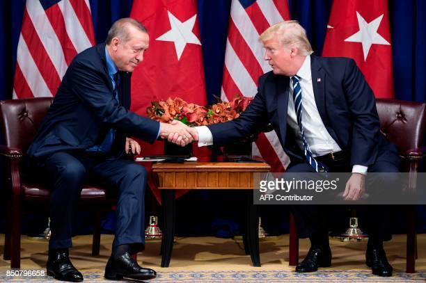 Turkey's President Recep Tayyip Erdogan and US President Donald Trump shake hands before a meeting at the Palace Hotel during the 72nd United Nations...