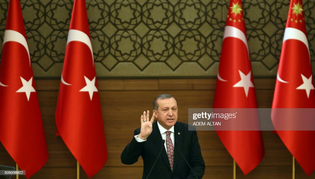 Turkey's President Recep Tayyip Erdogan delivers a speech during the monthly Mukhtars meeting (local administrators) at the Presidential Complex in Ankara on February 10, 2016. Turkish President Recep Tayyip Erdogan on February 10 accused the United States of creating a 'pool of blood' in the region by failing to recognise the main Syrian Kurdish organisations as terror groups. / AFP / ADEM ALTAN