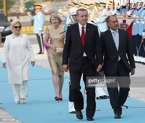 Turkey's President Recep Tayyip Erdogan his wife Emine New Zealand's GovernorGeneral Jerry Mateparae and his wife Janine review a guard of honour...