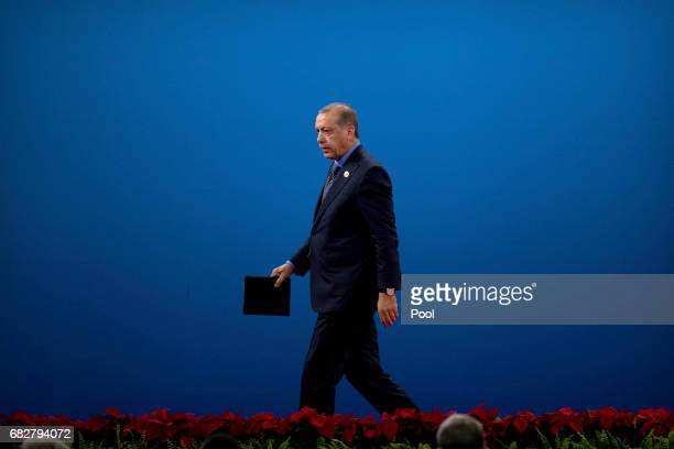 Turkey's President Recep Tayyip Erdogan leaves the stage after speaking during the opening ceremony of the Belt and Road Forum at the China National...