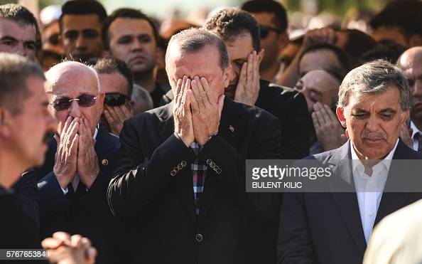 Turkey's President Recep Tayyip Erdogan reacts after attending the funeral of a victim of the coup attempt in Istanbul on July 17 2016 Turkish...