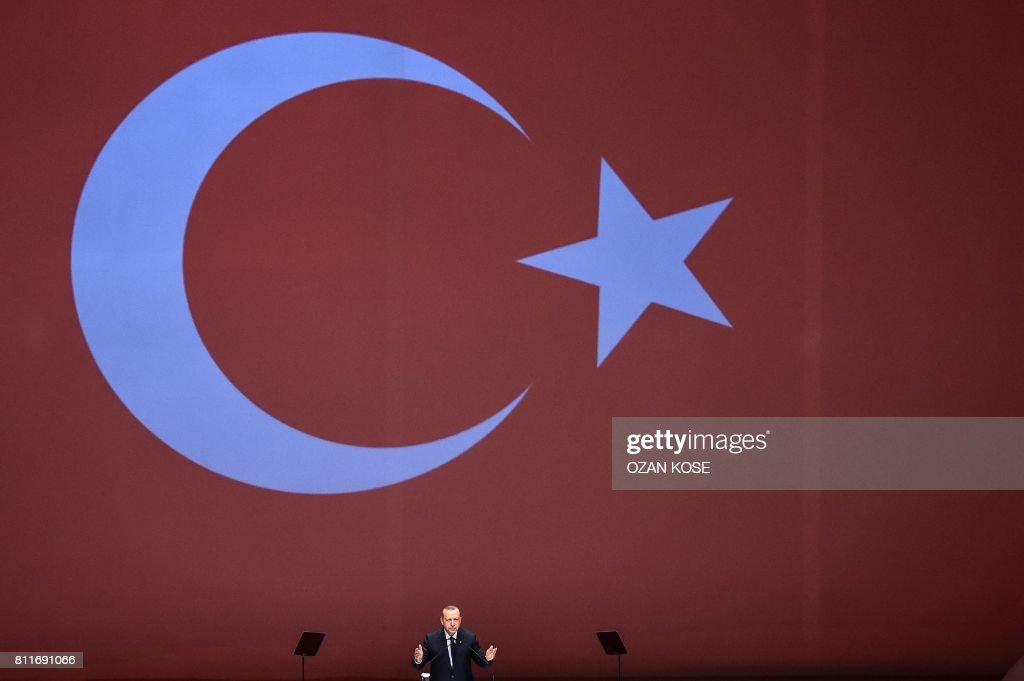 TOPSHOT - Turkey's President Recep Tayyip Erdogan speaks at the 22nd World Petroleum Congress (WPC) on July 10, 2017 in Istanbul. Turkish President Recep Tayyip Erdogan on July 10 warned global energy companies not to strike any deal with Cyprus for gas and oil exploration in the eastern Mediterranean, after talks missed a 'big opportunity' to unite the divided island. KOSE