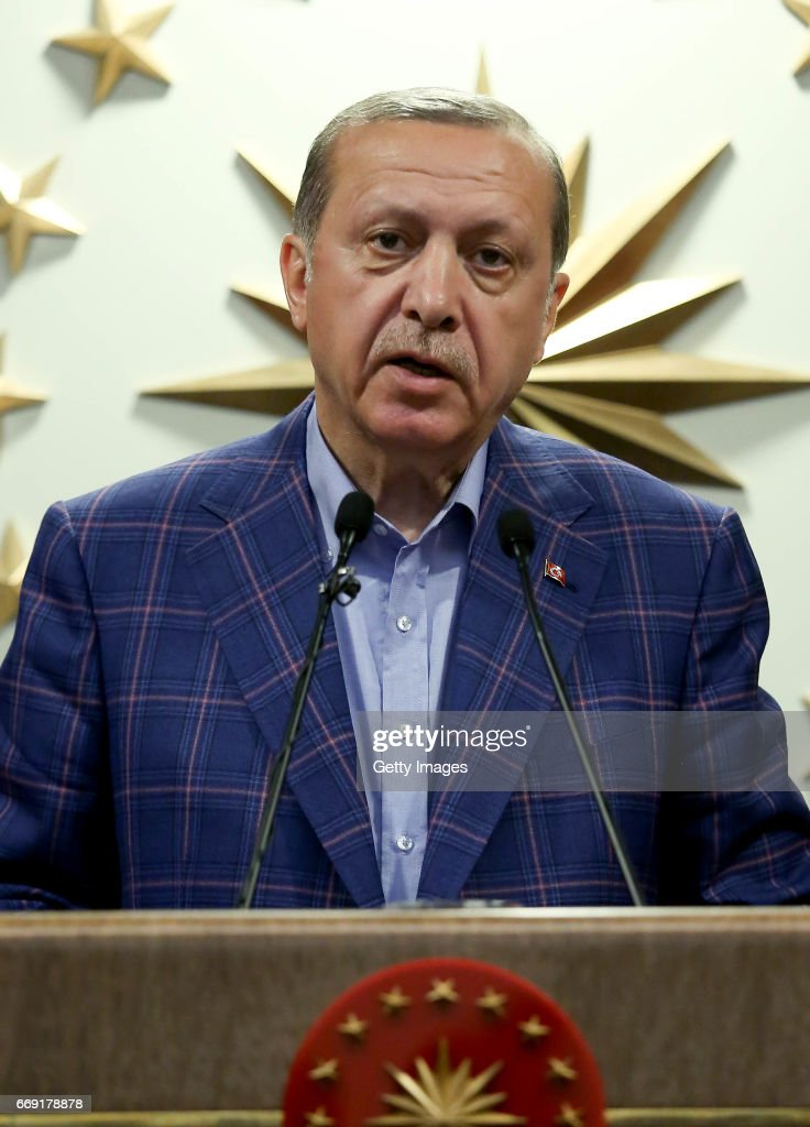 Turkey's President Recep Tayyip makes a statement on April 16, 2017 in Ankara, Turkey. President Erdogan declared victory in Sunday's historic referendum that will grant sweeping powers to the presidency, hailing the result as a historic decision. Results carried by the state-run Anadolu news agency showed the 'yes' vote had about 51.3 percent compared to 48.7 percent for the 'no' vote with nearly 99 percent of the vote counted.