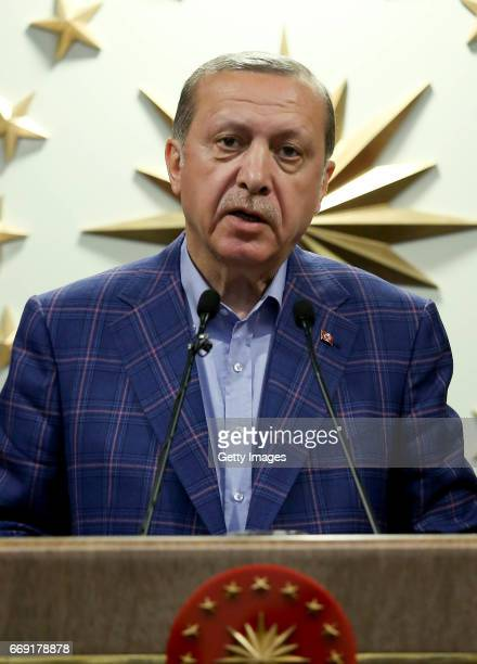 Turkey's President Recep Tayyip makes a statement on April 16 2017 in Ankara Turkey President Erdogan declared victory in Sunday's historic...