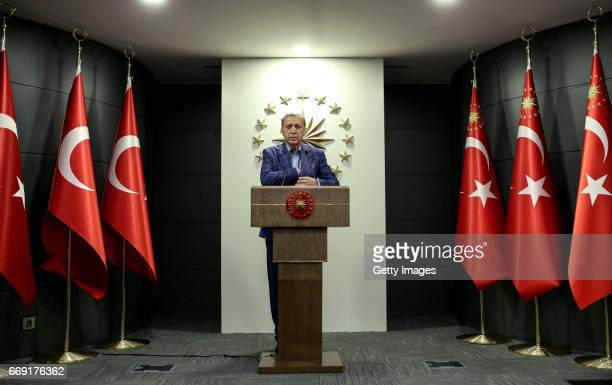 Turkey's President Recep Tayyip prepares to make a statement on April 16 2017 in Ankara Turkey President Erdogan declared victory in Sunday's...