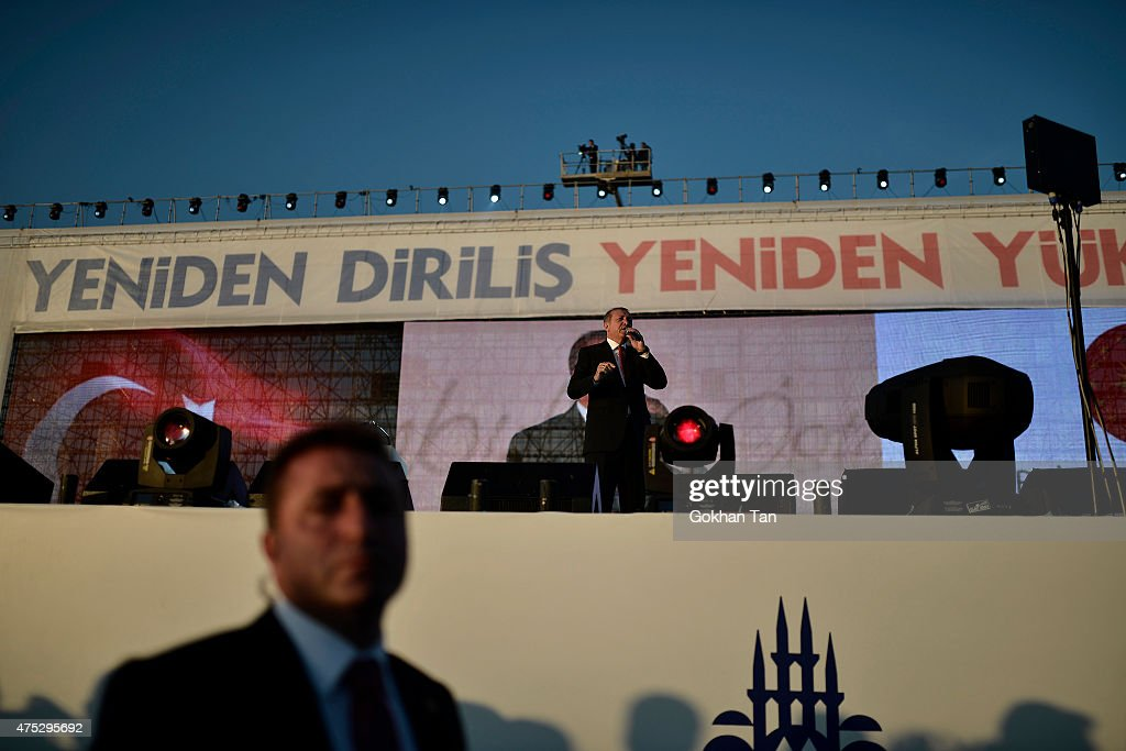 Turkey's President Tayyip Erdogan addresses his supporters during a ceremony to mark the 562nd anniversary of the conquest of the city by Ottoman Turks on May 30, 2015 in Istanbul, Turkey. Erdogan has reportedly been criticized by the opposition parties for campaigning in favor of the ruling Justice and Development Party (AKP), a party he co-founded, even though as head of state the constitution bars him from party politics. Turkey will hold a general election on June 7, 2015 to elect the 550 members of the Grand National Assembly.