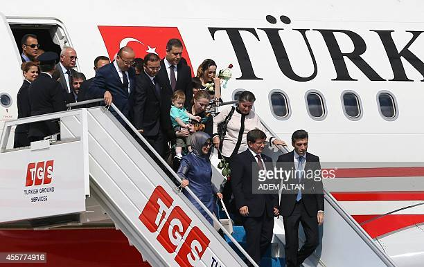 Turkeys Prime Minister Ahmet Davutoglu and his wife Sare Davutoglu welcome freed Turkey's Consul in Mosul Ozturk Yilmaz and dozens of other freed...