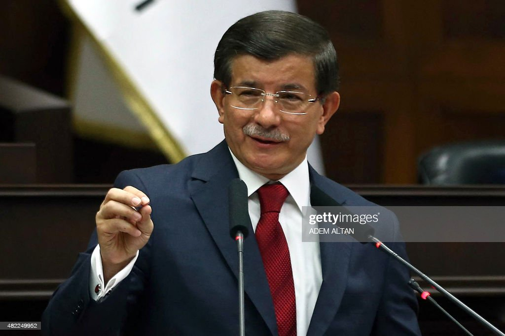 Turkey's Prime Minister <a gi-track='captionPersonalityLinkClicked' href=/galleries/search?phrase=Ahmet+Davutoglu&family=editorial&specificpeople=4940018 ng-click='$event.stopPropagation()'>Ahmet Davutoglu</a> delivers a speech during the parliamentary group meeting of the Justice and Development Party at the Grand National Assembly of Turkey (TBMM) in Ankara on July 29, 2015. Turkish warplanes on July 29 pounded targets of PKK militants in northern Iraq, as parliament met in emergency session to debate the government's controversial campaign against Kurdish rebels and jihadists. AFP PHOTO / ADEM ALTAN