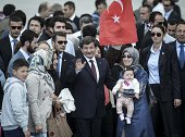 Turkeys Prime Minister Ahmet Davutoglu is with the relatives of released 49 hostages when Turkish consulate hostages who were held in northern Iraq...