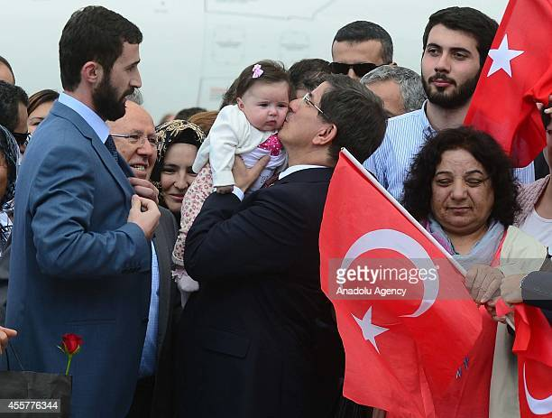 Turkeys Prime Minister Ahmet Davutoglu kisses a baby of freed 49 hostages when Turkish consulate hostages who were held in northern Iraq by ISIL more...