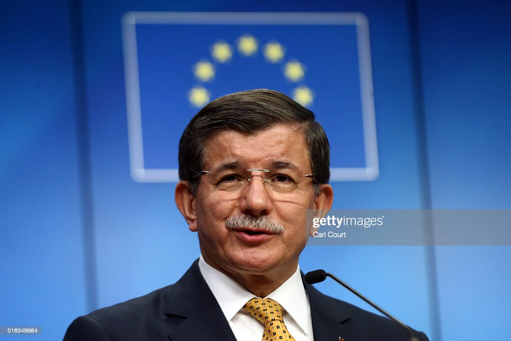 Turkey's Prime Minister, Ahmet Davutoglu, speaks during a press conference to discuss the migrant deal reached between Turkey and EU states, during a two-day EU summit, on March 18, 2016 in Brussels, Belgium. The EU has agreed a deal in which, from Sunday, all refugees and migrants arriving in Europe from Turkey will be returned to Turkey.